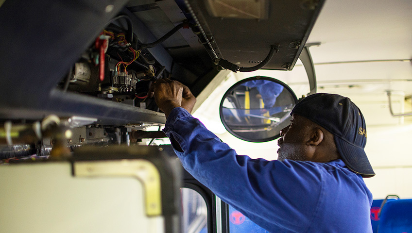Coach repair. Image 'Mechanic at East Garage' by Metro Transit (CC BY-NC-ND 2.0)